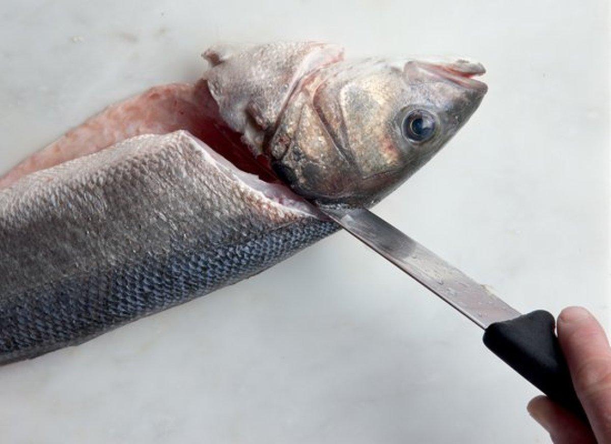 Using a sharp knife, make a diagonal cut on each side of the fish head.