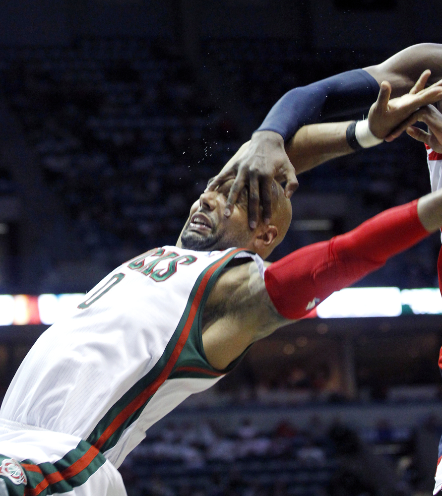Milwaukee Bucks' Drew Gooden is fouled by Washington Wizards' Chris Singleton during the first half of an NBA basketball game
