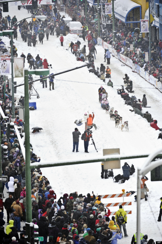 DeeDee Jonrowe and her team drive down 4th Avenue during the ceremonial start of the Iditarod Trail Sled Dog Race, Saturday,