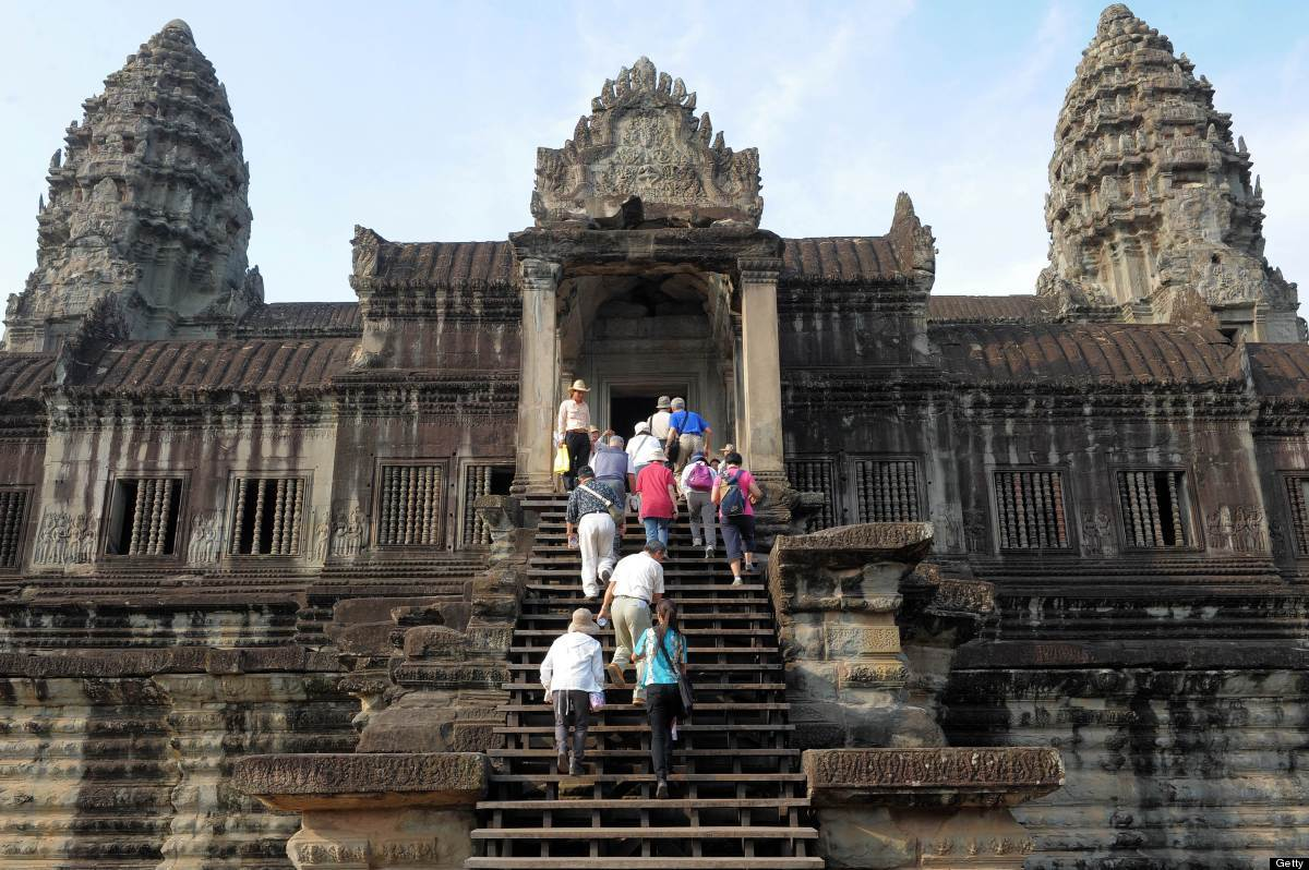 Tourists walkup to the world heritage Angkor Wat temple in Siem Reap province, some 300 kilometers northwest of Phnom Penh. T