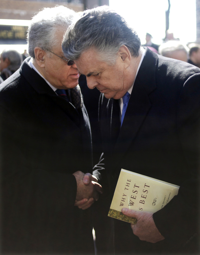 U.S. Rep. Peter King (R-N.Y), right, chairman of the House Committee on Homeland Security, meets with supporters at a news co