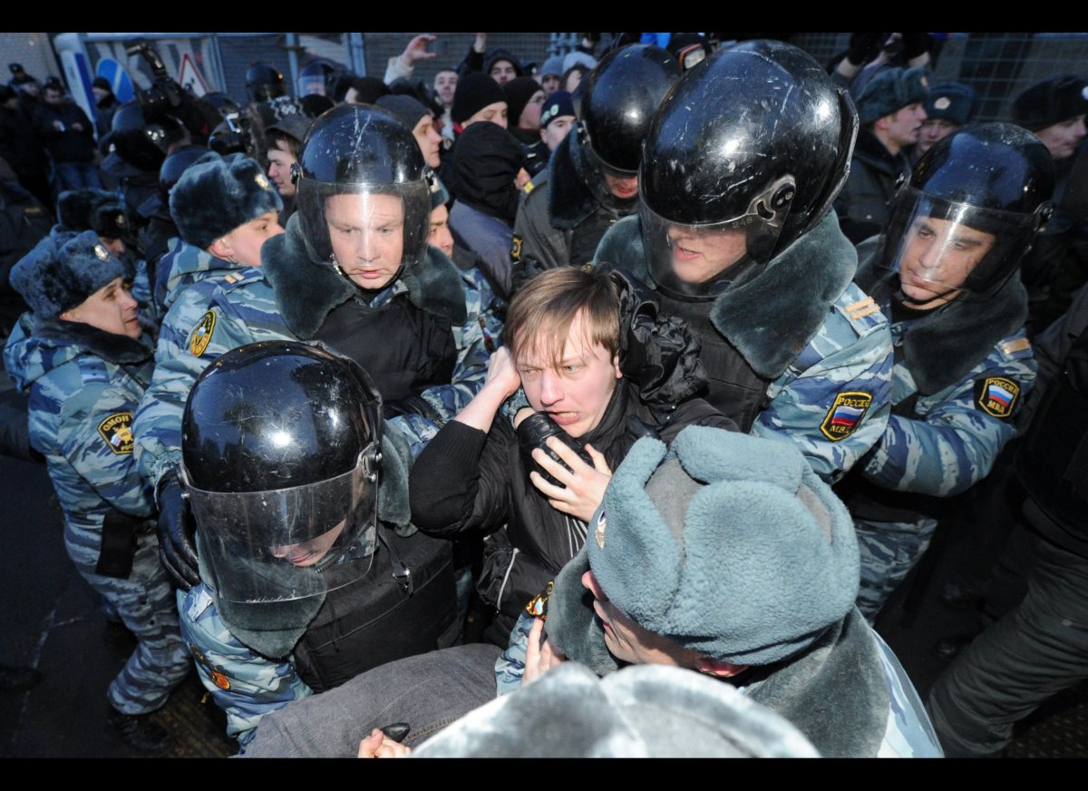 Police officers detain activists of the Other Russia movement who tried to hold an unsanctioned protest outside the central e