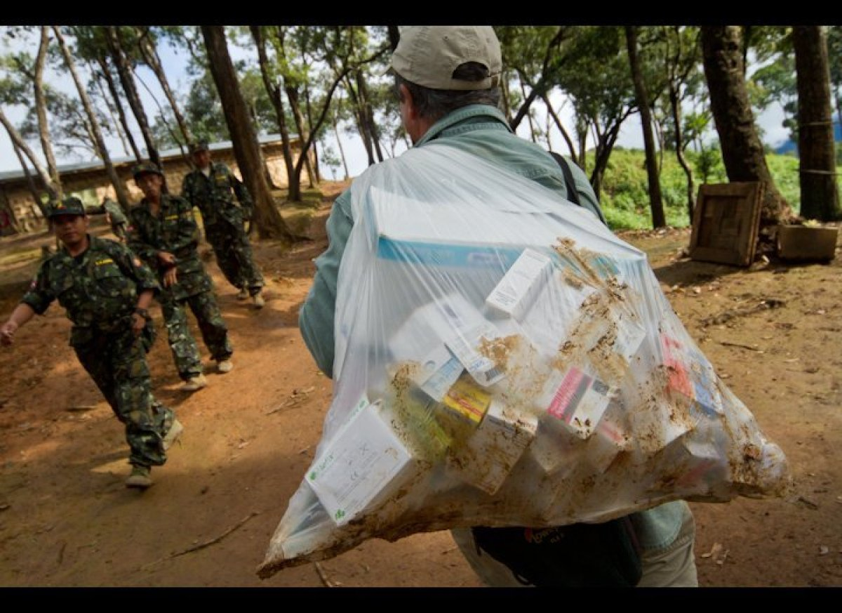 Dr. Pierre Olland delivers badly-needed medicine and supplies to a clinic at a Shan State Army training camp, near Loi Tai La