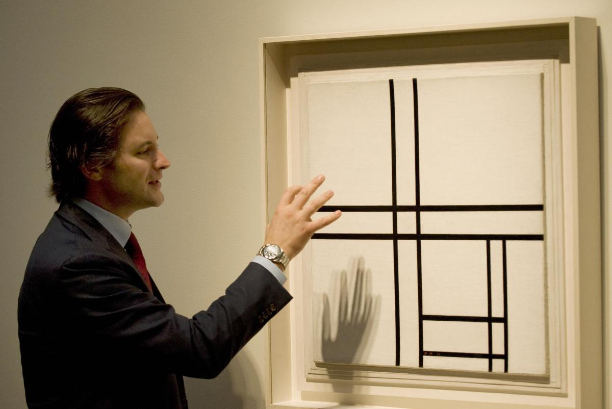 "Sotheby's Emmanuel DiDonna discusses Piet Mondrian's ""Composition in Black and White with Double Lines"" during a media previe"