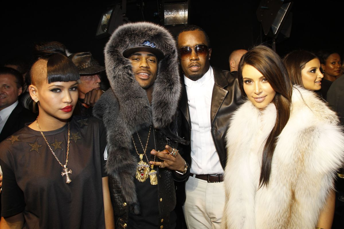 ARIS, FRANCE - MARCH 06: Cassie, guest, Sean 'Diddy' Combs and Kim Kardashian attend the Kanye West Ready-To-Wear Fall/Winter