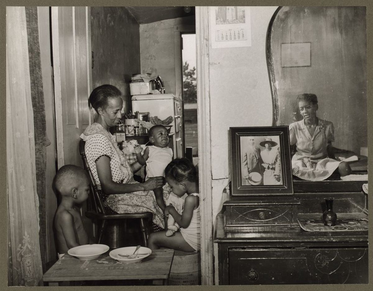 """Ella Watson was the subject of Parks' best known photograph: """"American Gothic, Washington, D.C."""" This photo shows Watson's th"""