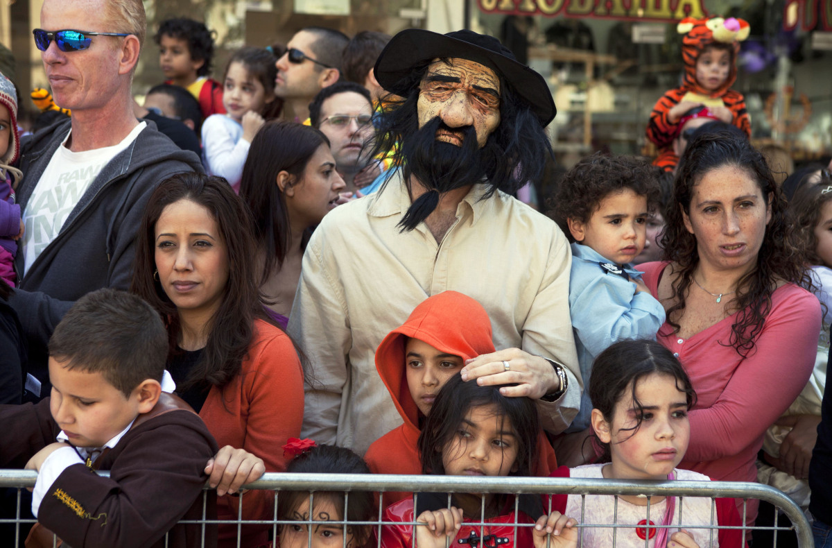 Israelis watch a Purim parade in Holon, Israel, Thursday, March 8, 2012. The Jewish holiday of Purim celebrates the Jews' sal