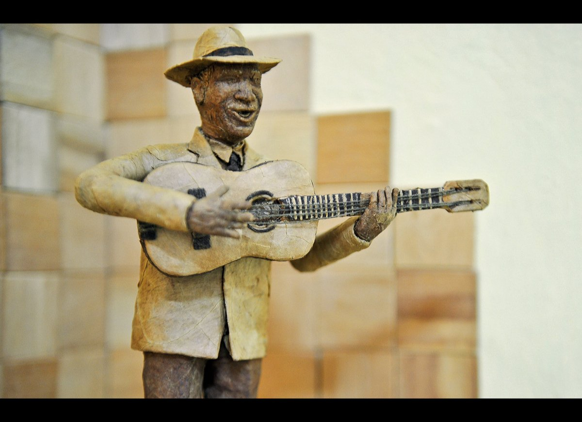 A 'Compay Segundo' (world famous Cuban musician) made with tobacco leaves by Cuban tobacco sculptor Janio Nunez, on February