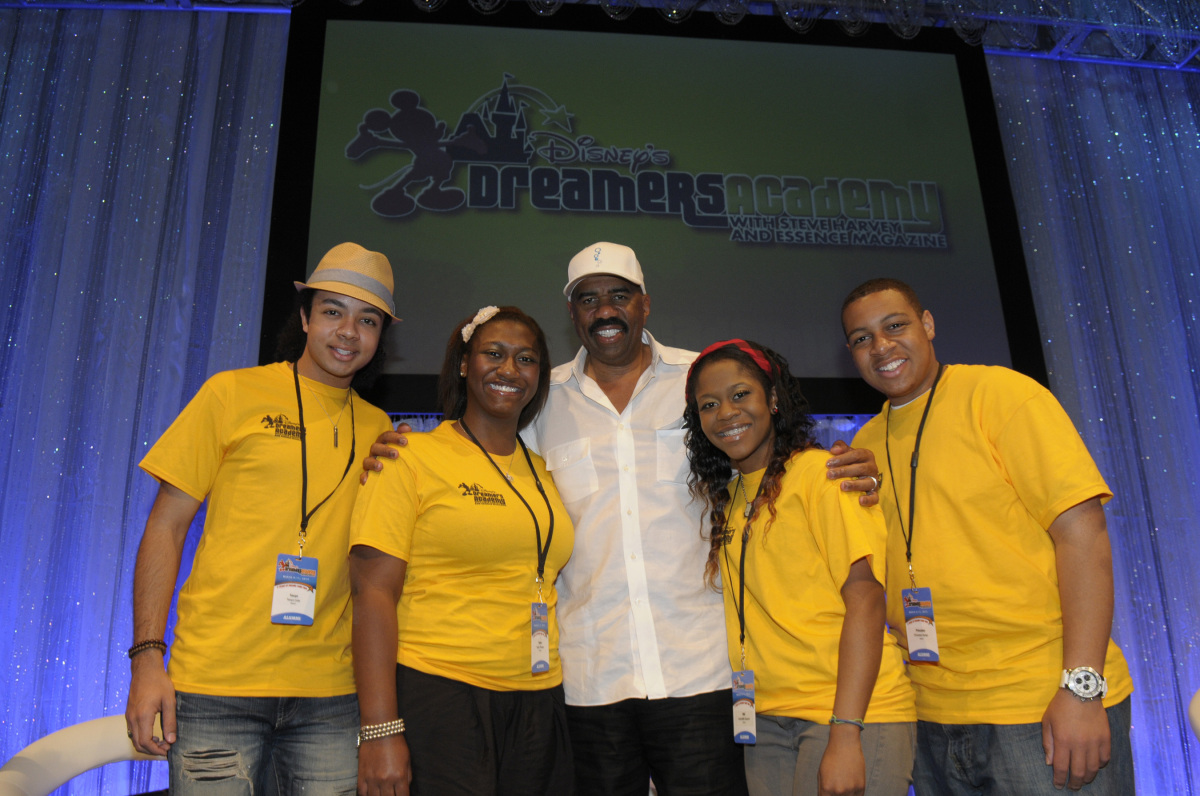 National entertainer and radio personality Steve Harvey poses March 9, 2012 with Disney's Dreamers Academy alumni (L-R) Tevyn