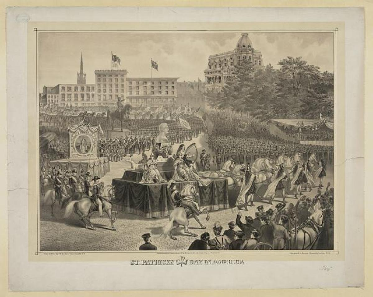 Print shows portion of a parade with float in the center bearing a bust of Daniel O'Connell, Saint Patrick's day in New York