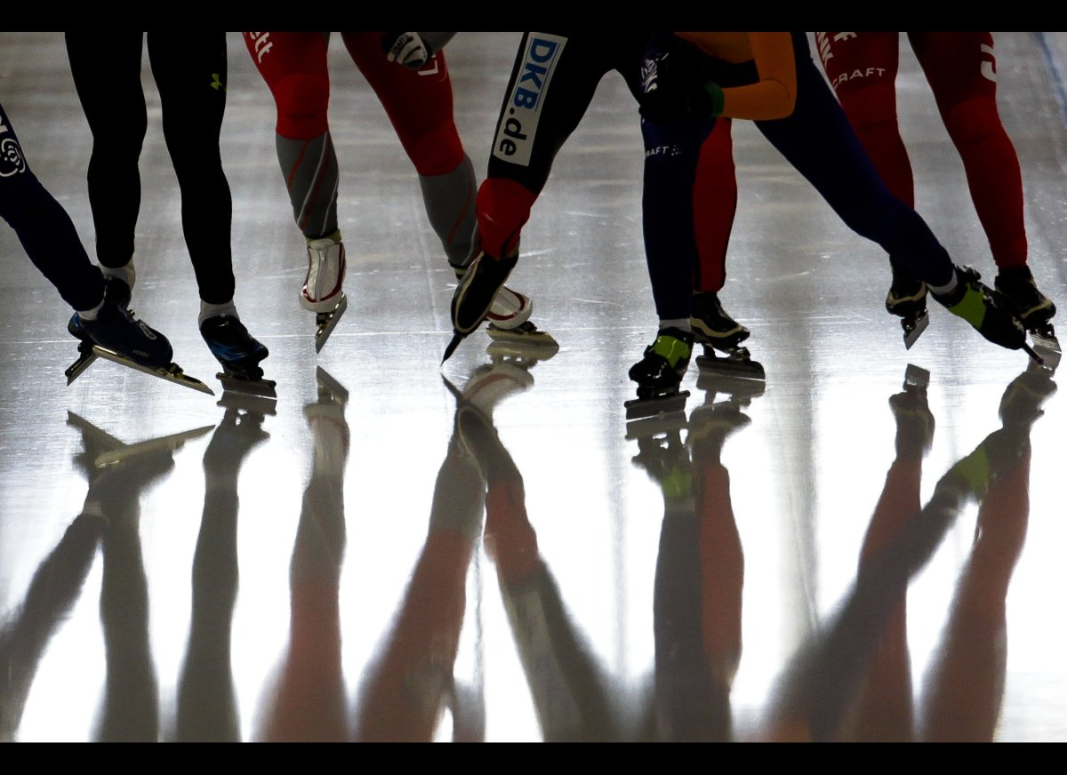 The legs of skaters reflected in the ice during a mass start competition at the speedskating World Cup in Berlin on March 11,