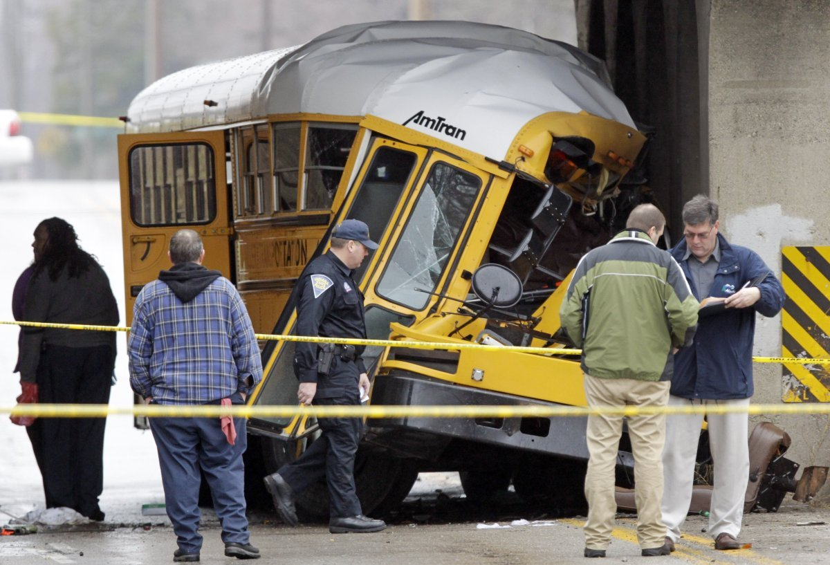 Investigators work the scene of a fatal bus crash on the southeast side of Indianapolis, Monday, March 12, 2012. The driver a