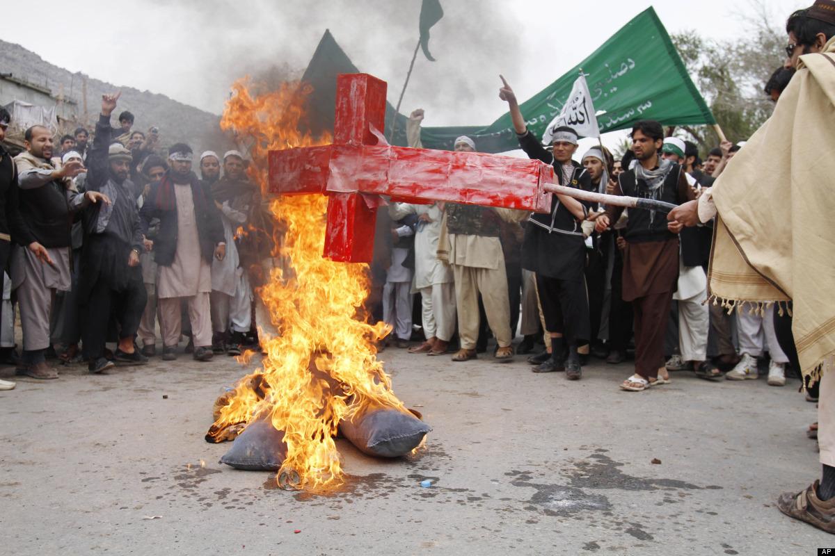 Afghans burn an effigy depicting U.S. President Barack Obama following Sunday's killing of civilians in Panjwai, Kandahar by