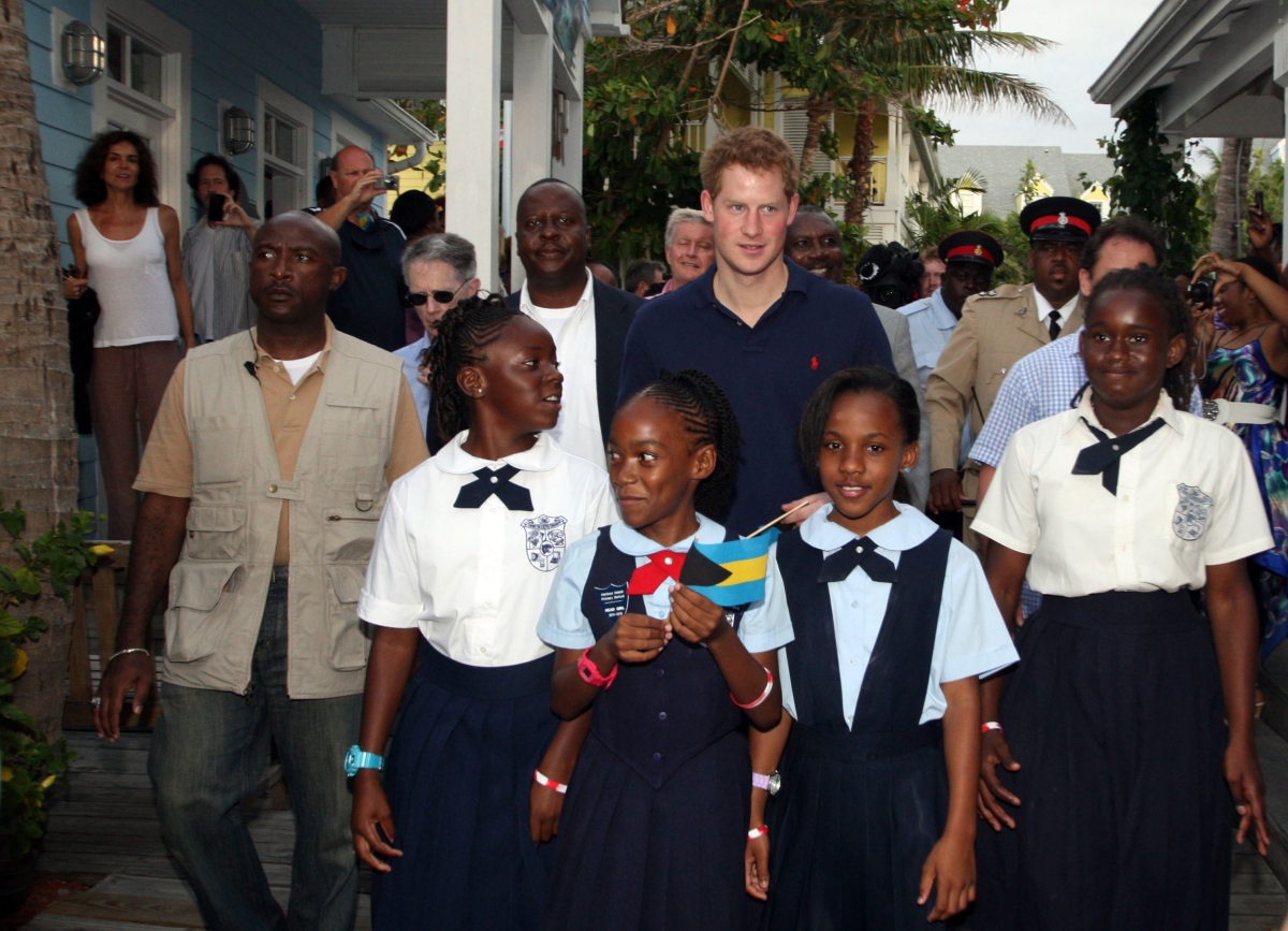Britain's Prince Harry poses for pictures with students in Hanbour Island, Bahamas, Sunday, March 4, 2012. The Prince visited