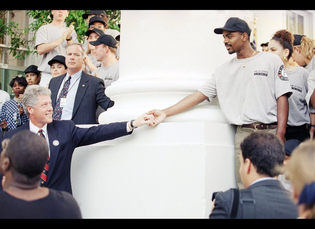 President Bill Clinton greets an unidentified member of his AmeriCorps program Monday, Sept. 12, 1994 at the White House in W