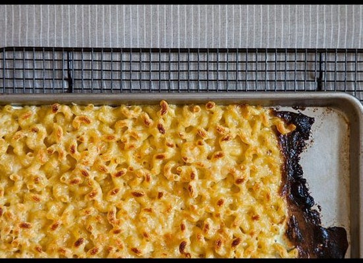I combined mac-and-cheese techniques by par-cooking the pasta, folding it together with a few cheeses, spreading it on a baki