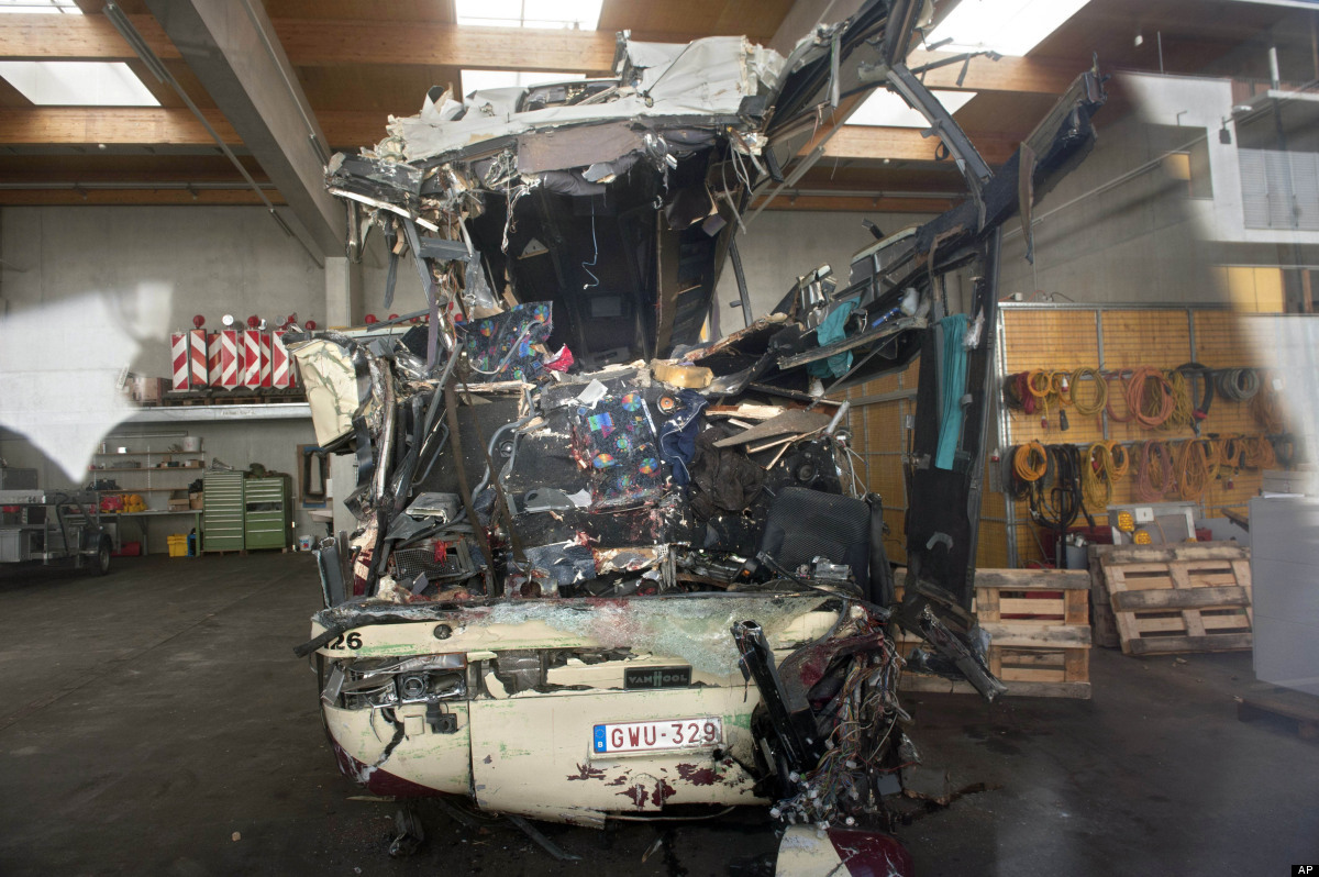 The wreckage of a tourist bus from Belgium is seen at a hangar of the maintenance center of the motorway A9, in Sierre, weste