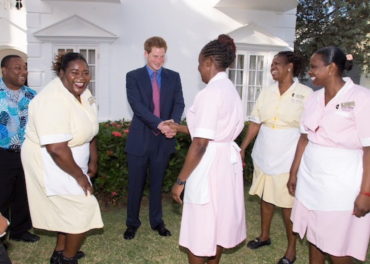 Prince Harry meets some of the Half Moon staff.