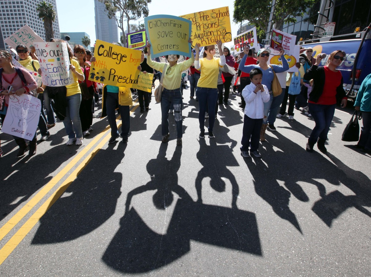 Los Angeles Unified School District employees and supporters gather to protest deep program cuts as the school board sought w