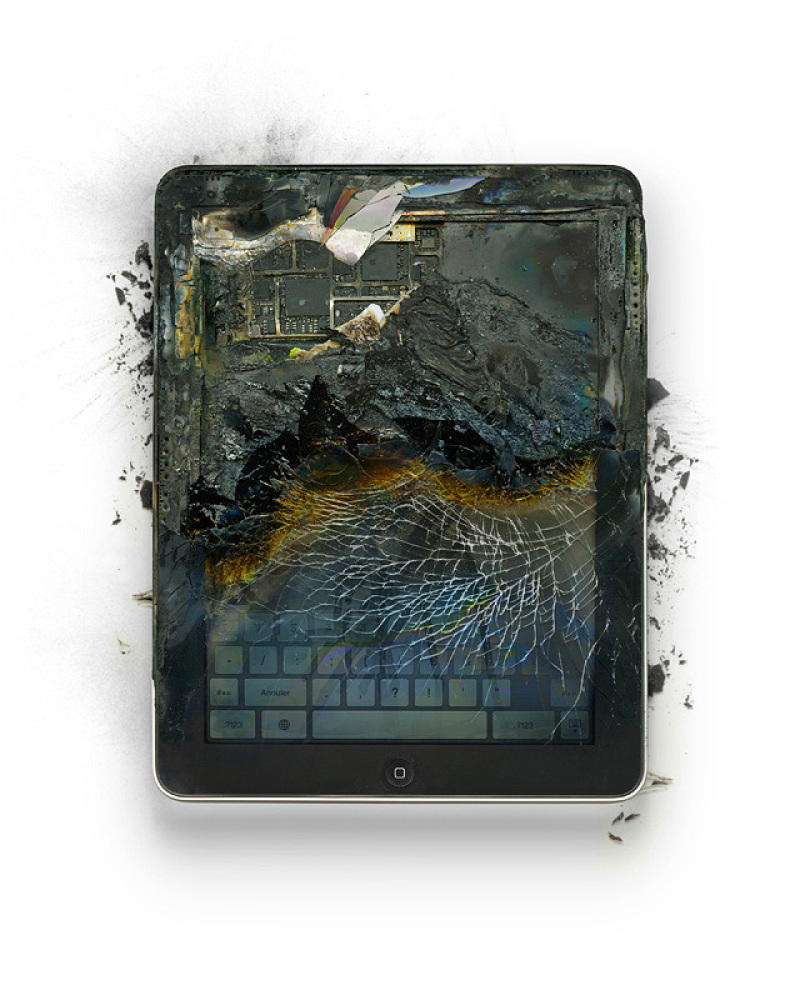 """Title: """"Book Burning"""" Device: 2010 iPad  Mode of Destruction: Soldering Torch  Image Credit: <a href=""""http://www.tompert."""