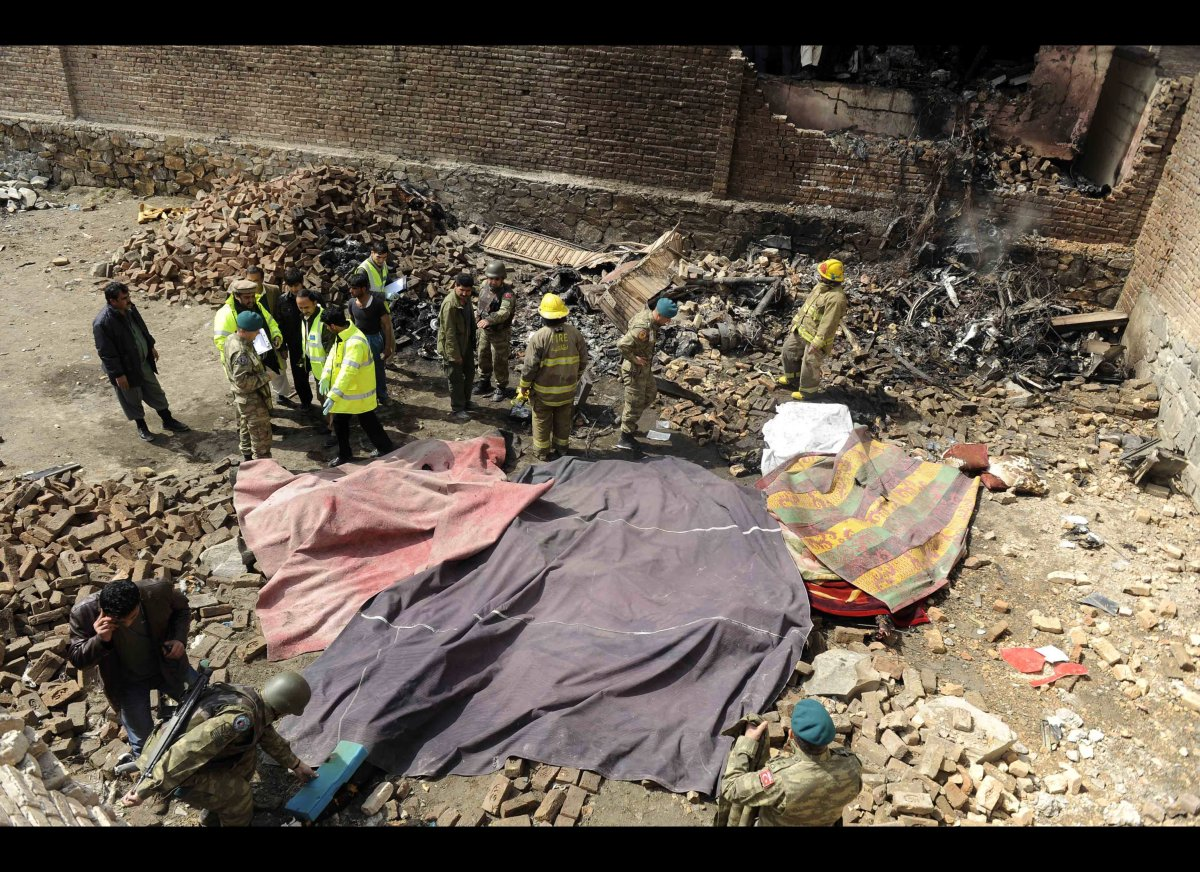 An overhead view shows rescue workers and army personnel at the site of a helicopter crash in Kabul on March 16, 2012.  Twelv
