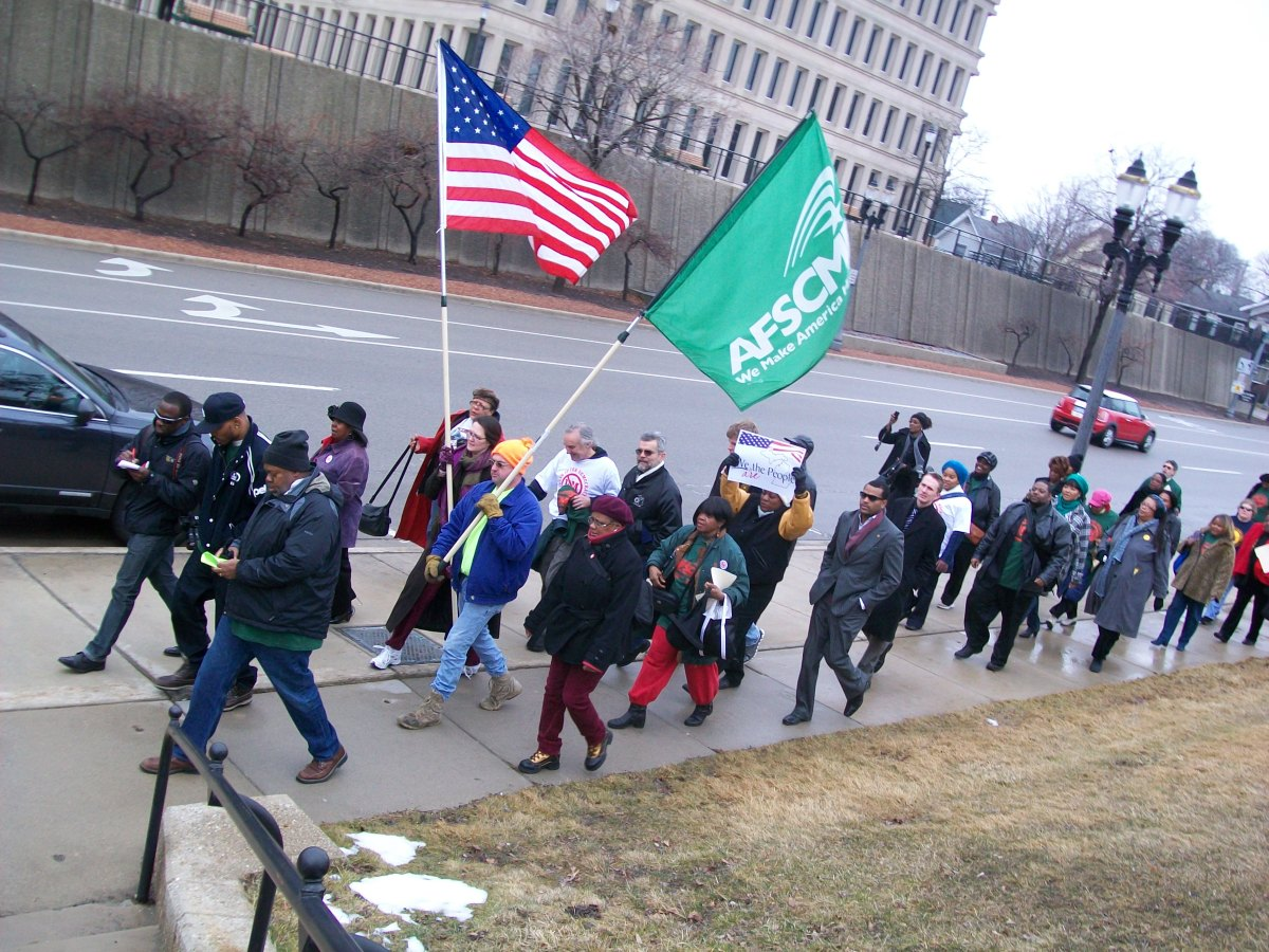Supporters of a petition to repeal Public Act 4 march to the Secretary of State's office in Lansing, Mich., Feb. 29, 2012.