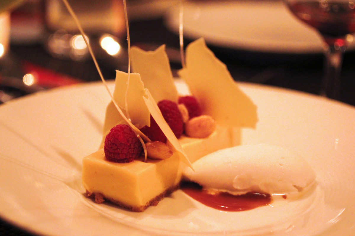 Yuzu-lime tart with caramel, dehydrated lime curd, crystallized ginger, Marcona almonds and raspberries.