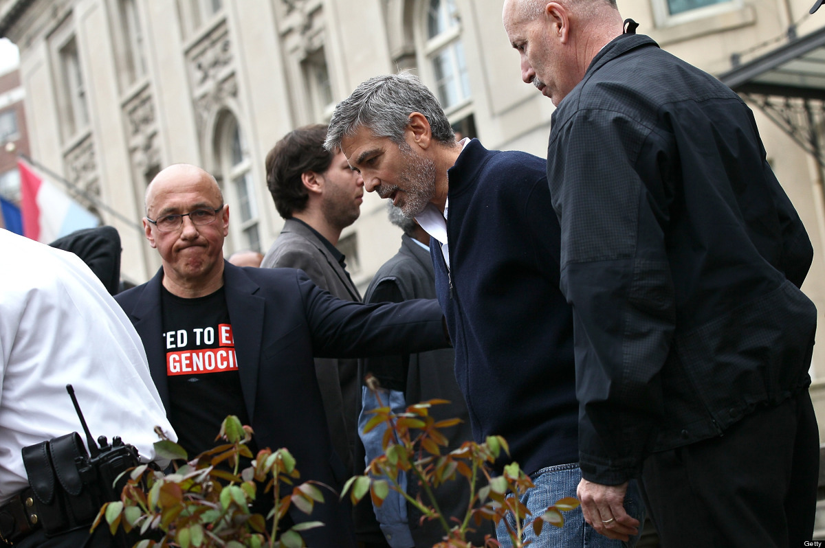WASHINGTON, DC - MARCH 16:  Actor George Clooney (2R) is arrested during a demonstration outside the Embassy of Sudan March 1