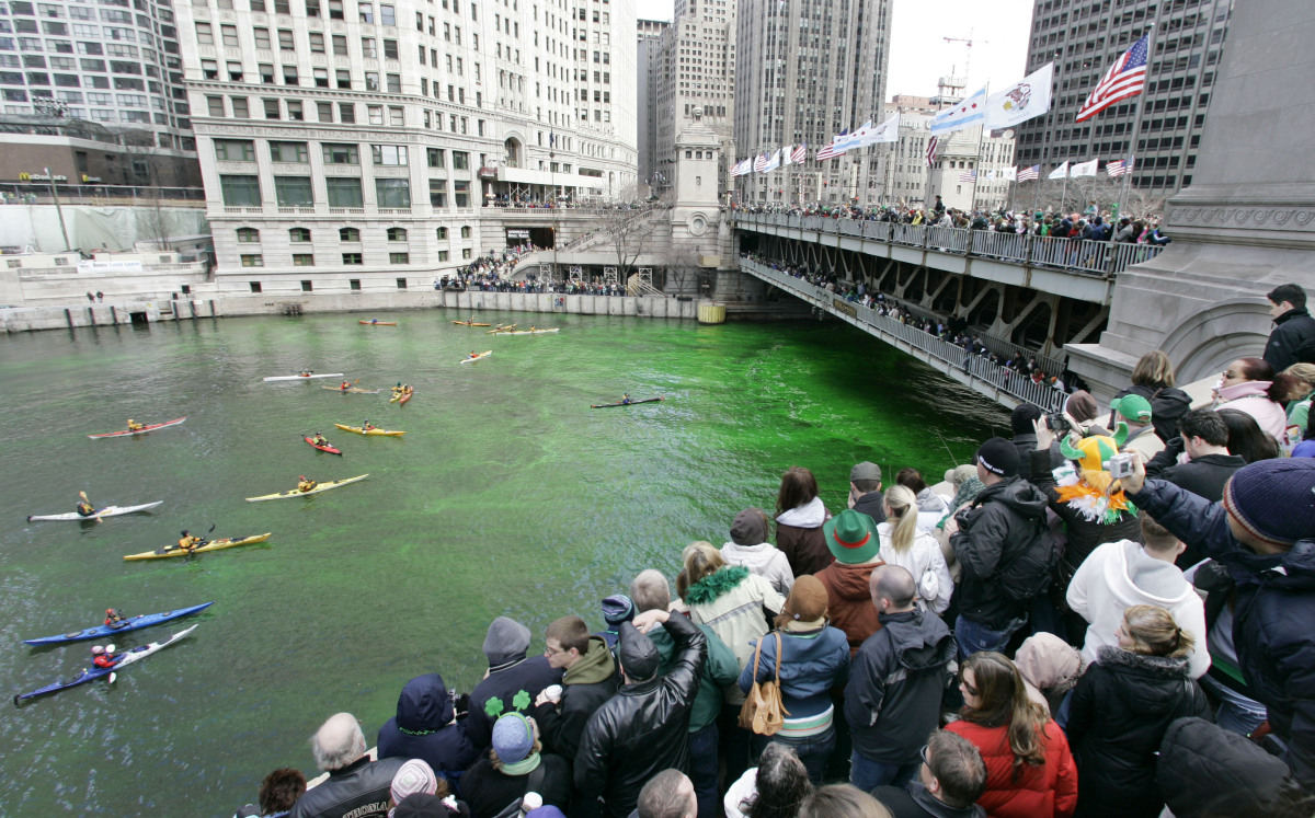 Thousands of people line the riverfront as the Chicago River is dyed green Saturday, March 17, 2007 as part of Chicago's cele