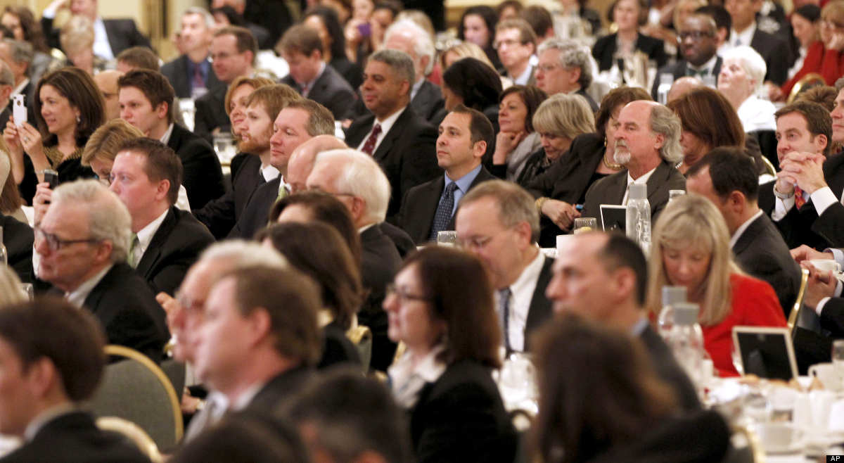 Audience members listen to President Barack Obama speaks during a 'Lawyers for Obama Luncheon', fundraiser, Friday, March 16,