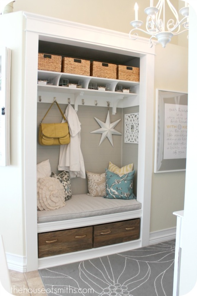 Remove the door on your hallway closet and transform the space into a lovely seating and storage area. It creates an inviting