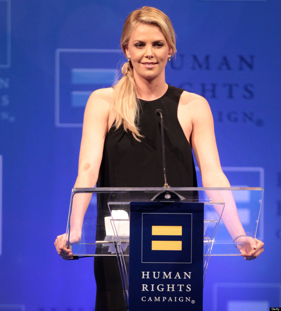 LOS ANGELES, CA - MARCH 17: Actress Charlize Theron lifts her drink for a toast during The Human Rights Campaign (HRC) Los An