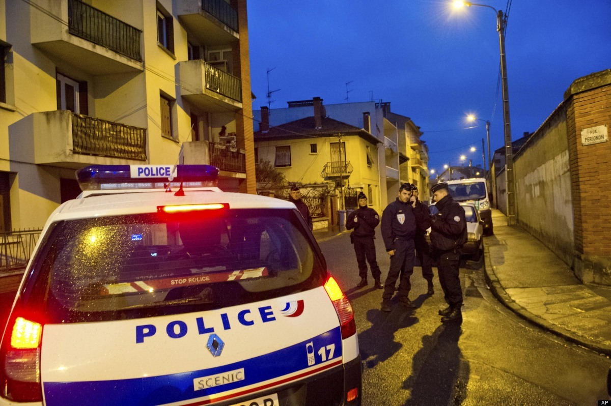 French police secure the area where they exchanged fire and were negotiating with a gunman who claims connections to al-Qaida