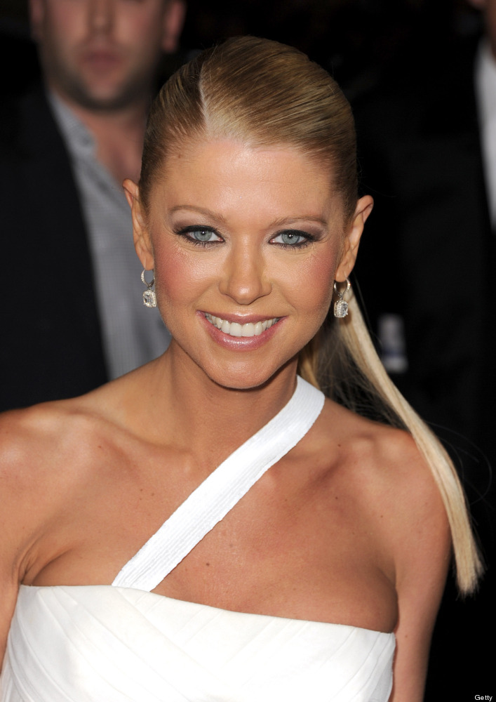"""HOLLYWOOD, CA - MARCH 19:  Actress Tara Reid poses at the premiere of Universal Pictures' """"American Reunion."""""""