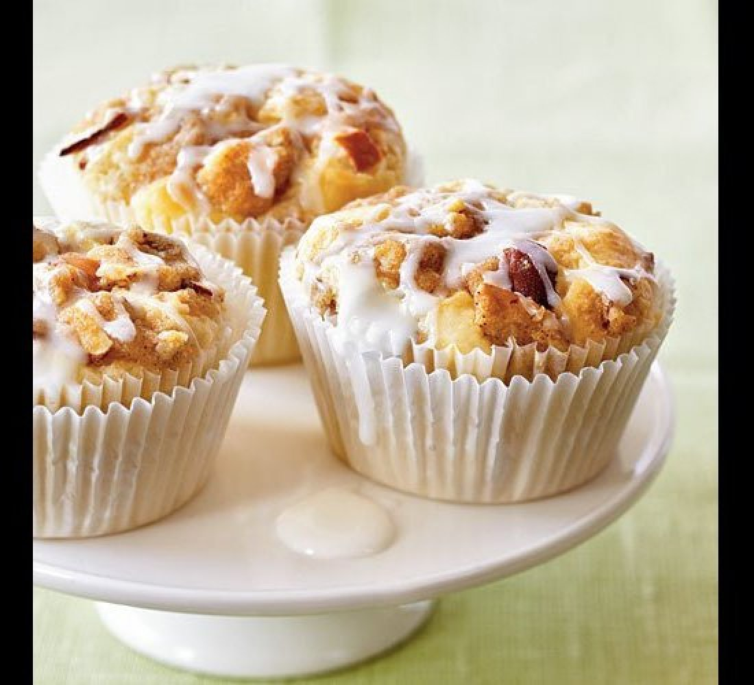 Top tender apple cupcakes with a sweet and crunchy topping of brown sugar and almonds, then drizzle with a powdered sugar gla