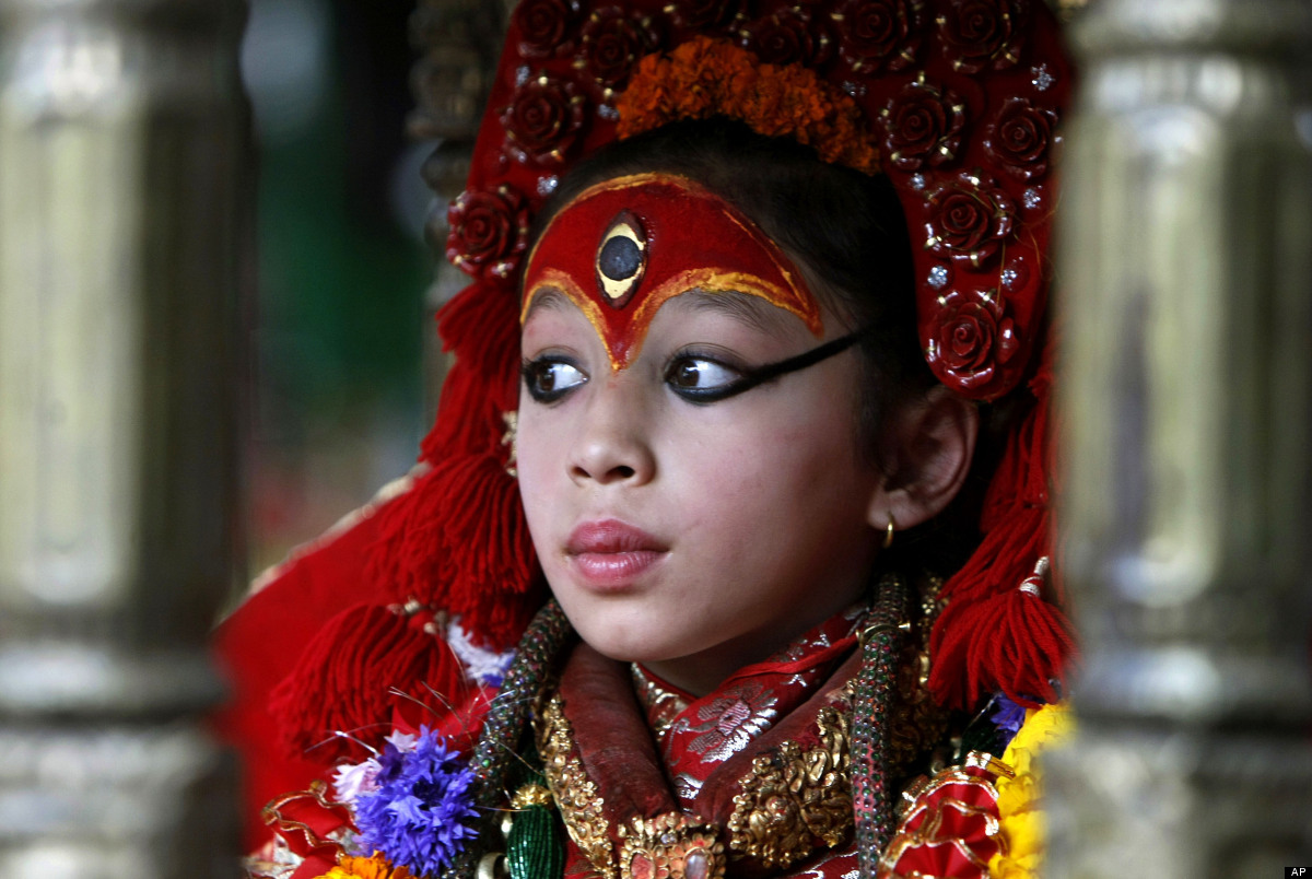 A Kumari, or living Goddess, sits on a palanquin carried by devotees towards the Ghode Jatra festival, an annual horse-racing