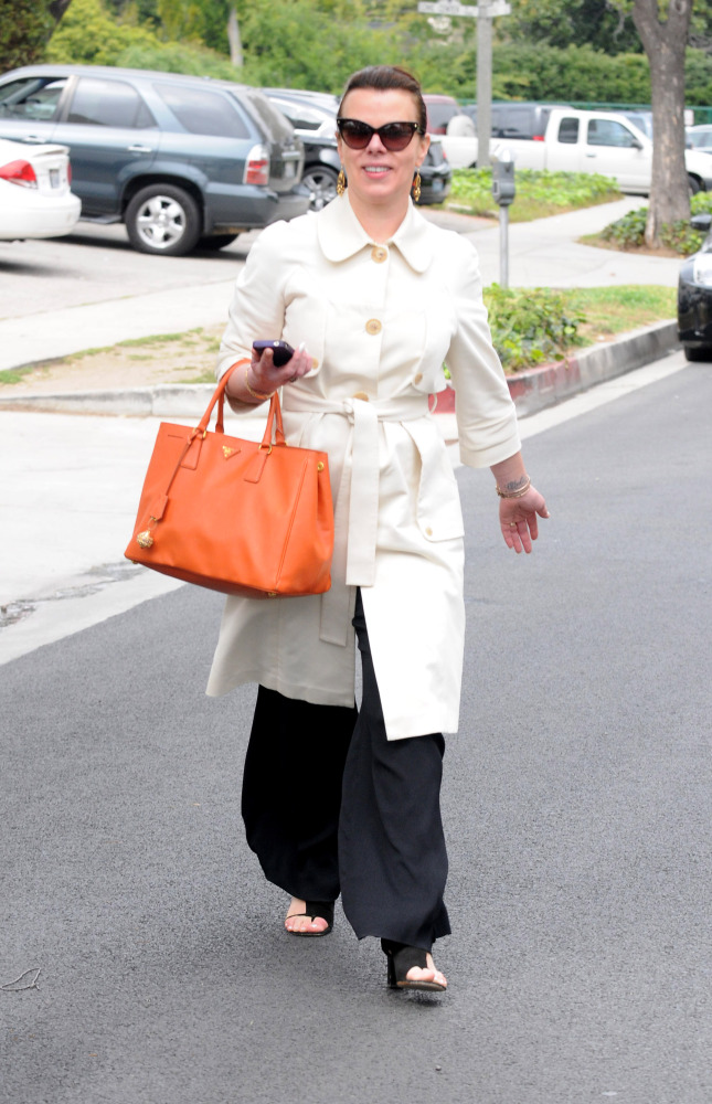 """A sleek trench and a bright bag usually make for a great look, but the wide-leg pants make the """"<a href=""""http://www.huffingto"""