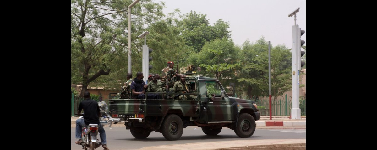 Soldiers from the presidential guard, said to be divided between those supporting the coup and those loyal to Malian Presiden
