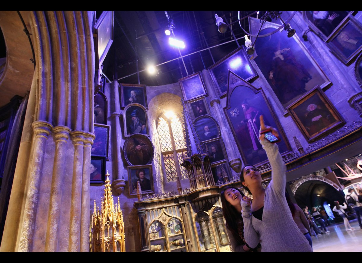 Two girls look around the set of Dumbledore's office at the new Harry Potter Studio Tour at the Warner Brothers Leavesden Stu