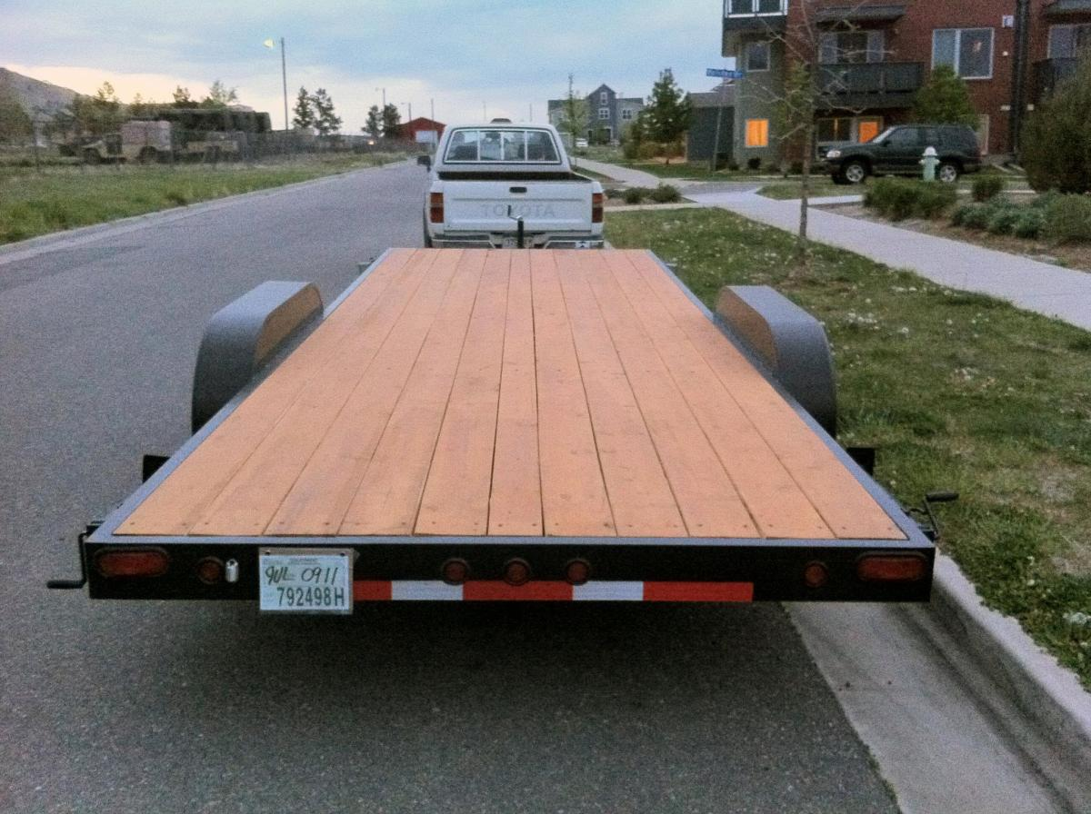"""Day 0, end of May: The trailer. Seems hard to believe that this will soon be a house?   <em>Photos via <a href=""""http://www."""