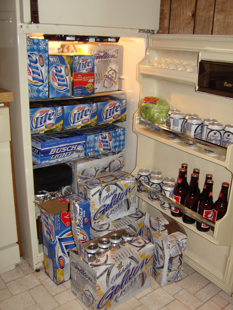 What we like about this fridge is that even though the amount of beer is quite literally bursting the door open, there's stil