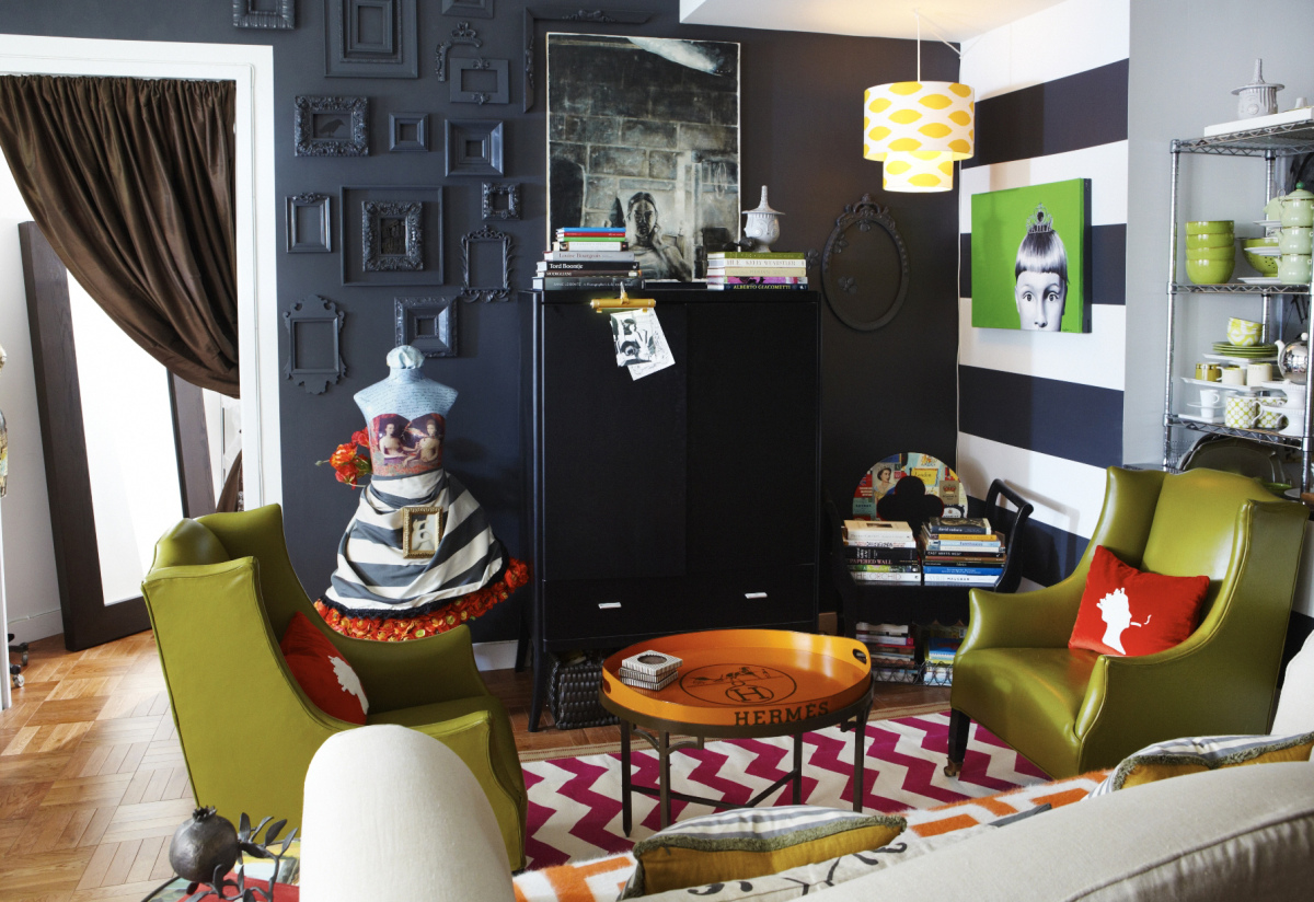 A peek inside Janet's apartment, which is all about color and drama. The walls were painted black for a 'receding' effect tha