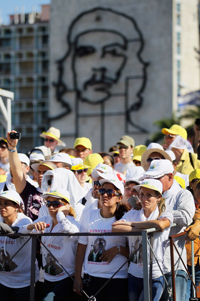 HAVANA, CUBA - MARCH 28:  People watch as Pope Benedict XVI conducts his mass at Havana's Revolution Square on the last day o