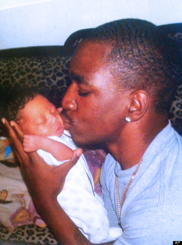 A photo released by the McDade family shows Kendrec McDade kissing his baby brother Keion in March 2012. Kendrec McDade was s
