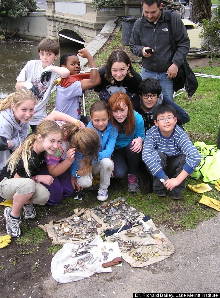 Students pose in front of treasure they found while cleaning Lake Merritt in Oakland, CA.