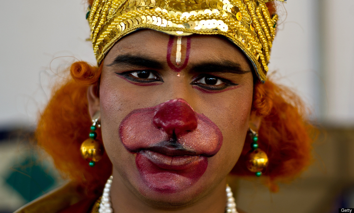 An Indian devotee dressed as Hindu monkey God Hanuman poses during a religious procession in New Delhi on April 12, 2011 to m