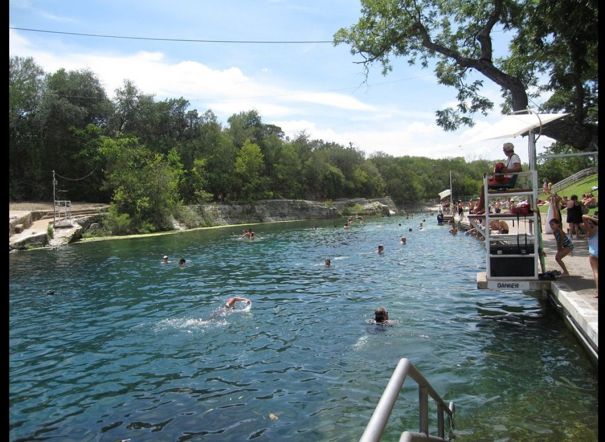Spring fed, more than 900 feet long, and with a natural rock and gravel bottom, the Barton Springs swimming pool is one of th