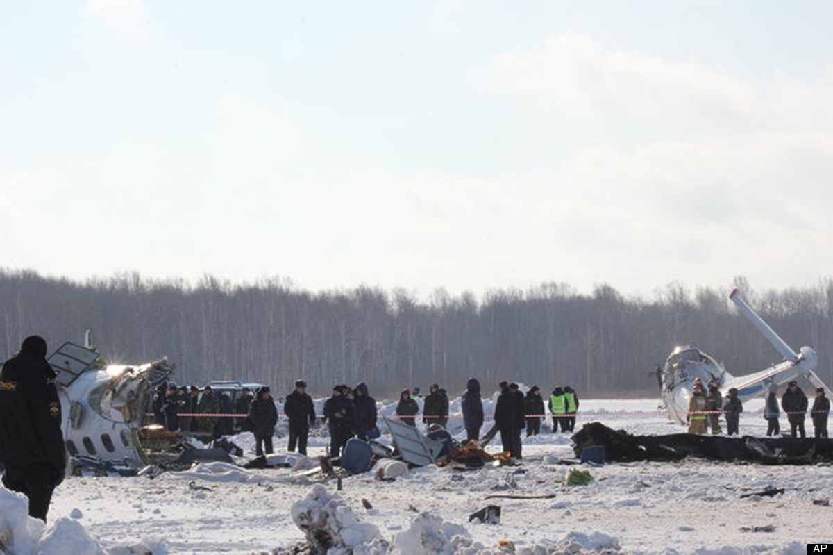 In this photo provided by Russia Emergency Situations Ministry press service, Russian emergency workers search the crash site