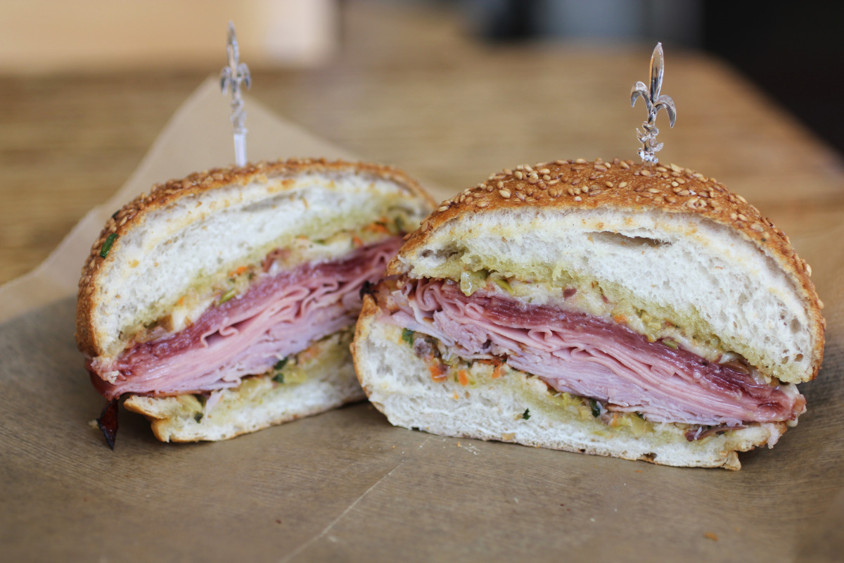 Guas' muffaletta sandwich is hot, unlike many that inspired it in New Orleans.