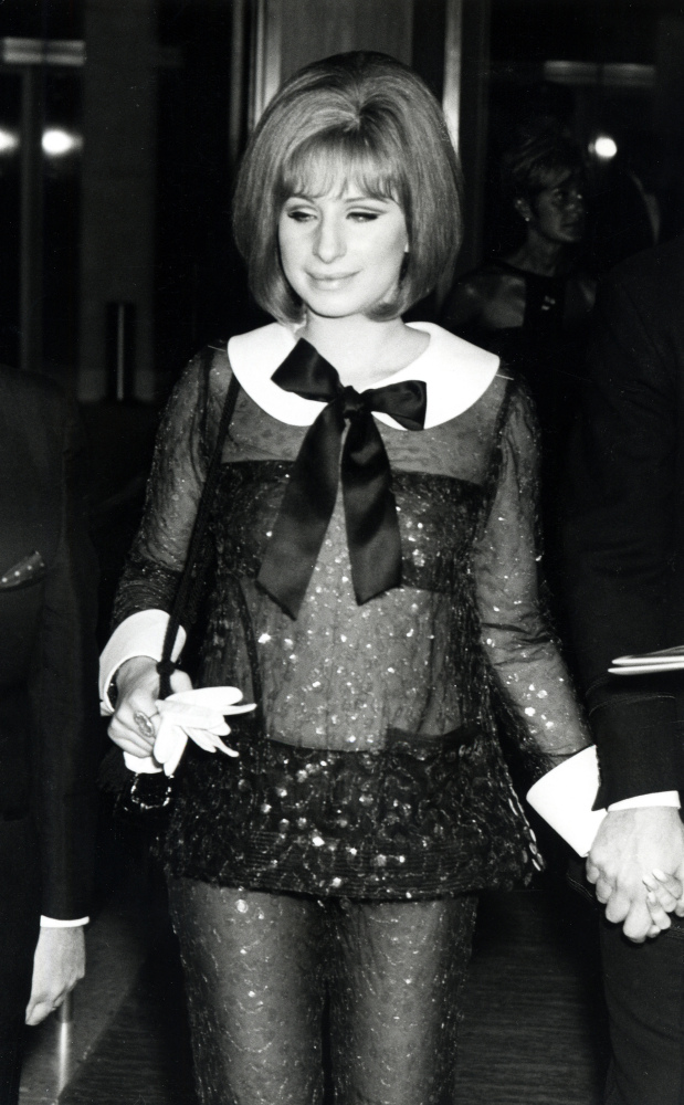 This sheer look surely caused some gasps when she showed up at the 1969 Academy Awards. We love the cheeky collar: it's both